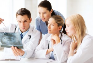 healthcare, medical and radiology concept - group of doctors loo